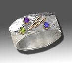 silver/gold ring with peridot