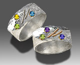 chased ring with gemstones